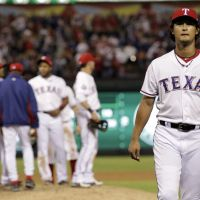 Long kiss goodnight: Rangers pitcher Yu Darvish walks off the mound during the seventh inning of the AL Wild-Card game on Friday in Arlington, Texas. The Orioles beat the Rangers 5-1.   AP