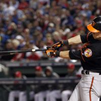 Up to the challenge: Orioles outfielder Nate McLouth hits an RBI single against Texas on Friday.   AP