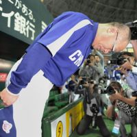 Attitude adjustment: Hiromitsu Ochiai's surly disposition won him few admirers during his time as a manager. | KYODO