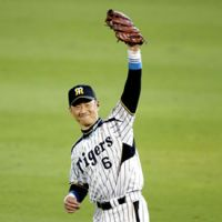 End of a great career: Hanshin Tigers outfielder Tomoaki Kanemoto goes 1-for-4 at the plate in his final game in a 3-0 season-ending triumph over the visiting Yokohama BayStars on Tuesday at Koshien Stadium. Kanemoto is seventh on NPB's all-time hits list and eighth in RBIs. | KYODO