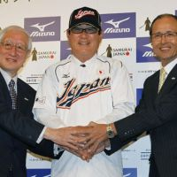 Let's get to work: Japan manager Koji Yamamoto is flanked by NPB commissioner Ryozo Kato (left) and Sadaharu Oh on Wednesday in Tokyo. | KYODO