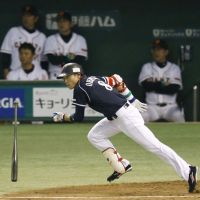 In flight: Chunichi's Yohei Oshima takes off after hitting an RBI single in the third inning of the Dragons' 3-1 win over the Giants in the opening game of the Central League Climax Series final round on Wednesday. | KYODO