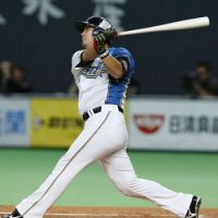 Key performance: Hokkaido Nippon Ham slugger Sho Nakata hits a two-out RBI double in the first inning against Fukuoka Softbank in Game 3 of the Pacific League Climax Series on Friday at Sapporo Dome. The Fighters beat the Hawks 4-2 to wrap up the series. | KYODO