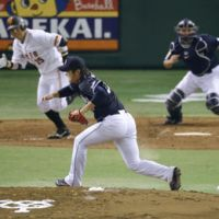 Line of fire: Chunichi pitcher Soma Yamauchi grimaces after being hit on the shin by a drive by Yomiuri's Shuichi Murata on Sunday night.   KYODO