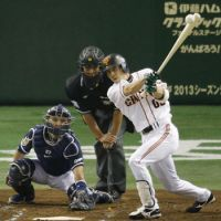 Dragon slayer: Yomiuri's Takayuki Terauchi drives in a pair of runs in the second inning of the Giants' 4-2 win over the Dragons in Game 6 of the Central League Climax Series final stage on Monday. | KYODO