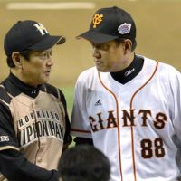 Fighters manager Hideki Kuriyama, seen with his Giants counterpart Tatsunori Hara before Game 1 of the Japan Series on Saturday, says Hokkaido Nippon Ham shouldn't put too much pressure on itself despite a big loss in the series opener. | KYODO