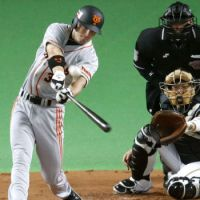 Staying aggressive: Giants slugger John Bowker blasts a two-run home run in the second inning of Game 5 of the Japan Series on Thursday at Sapporo Dome. Yomiuri defeated the Hokkaido Nippon Ham Fighters 10-2. | KYODO