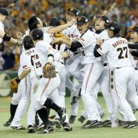 We are the champions: The Yomiuri Giants celebrate their Japan Series title on Saturday evening after beating the Hokkaido Nippon Ham Fighters 4-3 in Game 6 at Tokyo Dome. | KYODO