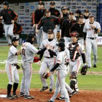 Yomiuri Giants players celebrate their first win Sunday at the Asia Series Championship after beating the Taiwan champion Lamigo Monkeys 6-3.   KYODO