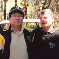 Dear friends: Maruto Higuchi and Jim Moynihan pose for a photo at a golf tournament  in Tampa, Florida, in 2004. | JIM MOYNIHAN