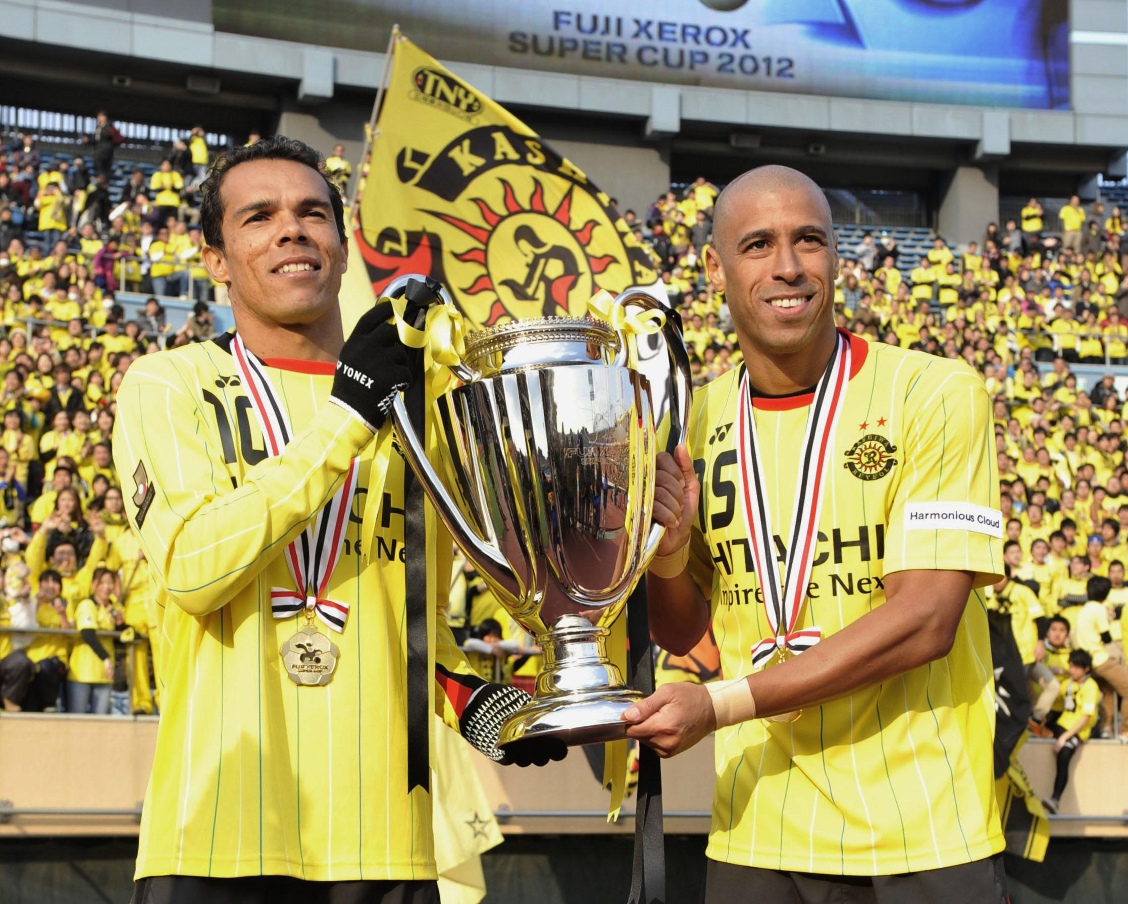 Successful start: Reysol players Leandro Domingues (left) and Jorge Wagner lead their team to a 2-1 win over FC Tokyo on Saturday in the Xerox Super Cup at National Stadium. | KYODO