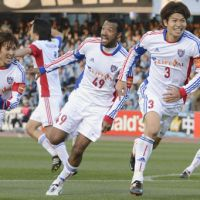 Masato Morishige (second from right) smiles Sunday after scoring a goal in the 87th minute and giving FC Tokyo a 1-0 win over Kawasaki Frontale. | KYODO PHOTO