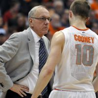 In his element: Syracuse head coach Jim Boeheim, interacting with guard Trevor Cooney during a recent game, has had a profound impact on the basketball career of Gunma head coach Ryan Blackwell. | AP