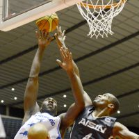 Final flourish: Panasonic's Jameel Watkins (left) shoots as Aisin's Kevin Young (right) defends during the Trians' 64-61 win in the final of the All-Japan Championship on Monday. | KYODO