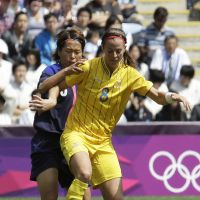 Doing the dirty work: Azusa Iwashimizu (rear) attempts to take the ball from Sweden's Lotta Schelin during their match on Saturday in Coventry, England. | AP