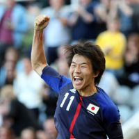 Leaving it late: Kensuke Nagai celebrates his 84th-minute goal in Japan's 1-0 win over Morocco on Sunday. The victory earned Japan a place in the Olympic quarterfinals. | AP
