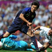 Still standing: Kensuke Nagai scores Japan's first goal during a 3-0 win over Egypt in the Olympic quarterfinals on Saturday at Old Trafford.   AFP-JIJI