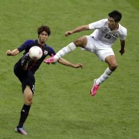 Mexico keeps poise, rallies to beat Japan