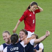 Homare Sawa looks on as members of the U.S. women's soccer team celebrate their 2-1 victory over Japan at Wembley Stadium Thursday evening. | KYODO PHOTO