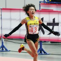 London calling: Yoshimi Ozaki crosses the line to finish second at the Nagoya Women's Marathon on Sunday. | KYODO