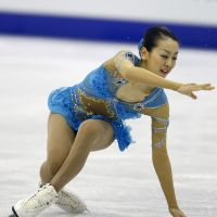 Shaky start: Mao Asada falls while attempting a triple axel during the short program at the world championships in Nice, France, on Thursday night. Mao is in fourth place heading into Saturday's free skate. | AP