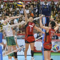 Dynamic duo: Japan's Daisuke Usami and Kota Yamamura work in tandem at the net against Australia in a FIVB Olympic men's volleyball qualifying tournament match on Thursday. Japan defeated Australia 25-22, 25-23, 25-12 at Tokyo Metropolitan Gymnasium. | KYODO