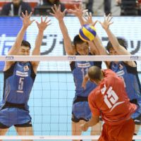 Tight quarters: Puerto Rico's Ezequiel Cruz competes against a Japanese trio in their FIVB Olympic men's volleyball qualifying match on Saturday at Tokyo Metropolitan Gymnasium. Japan lost the first set before rattling off three straight wins to prevail. | KYODO