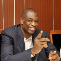 Growing legacy: Former NBA star Dikembe Mutombo speaks at a recent meeting of the Foreign Sportswriters Association of Japan in Tokyo. | YOSHIAKI MIURA