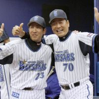Keep your head up: The always-animated Kiyoshi Nakahata (right) has lifted the BayStars' spirits, but the team is stuck at the bottom of the standings. | KYODO