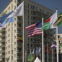 Let the games begin: Flags fly in the wind outside the Olympic Village in London on Thursday. | AP