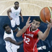 Gladiator: Tunisia's Makram Ben Romdhane drives to the basket during his team's Olympic Group A game against Nigeria in London on Sunday. Nigeria won 60-56. | AP