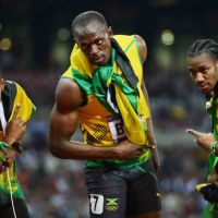 Center of attention: Silver medalist Yohan Blake (right) and bronze medalist Warren Weir made their presence felt during the 200-meter final, but it was their superstar teammate Usain Bolt who stole the show. | AFP-JIJI