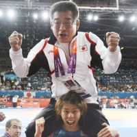Dynasty: Saori Yoshida remained golden in London by winning her third straight 55-kg Olympic wrestling title.   KYODO