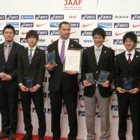 Getting recognized: (From left) Anna Doi, Genki Dean, Kentaro Nakamoto, Koji Murofushi, Ryota Yamagata, Masashi Eriguchi and Shinji Takahira are honored at the 2012 JAAF Athletic Awards event on Thursday in Tokyo. | KAZ NAGATSUKA