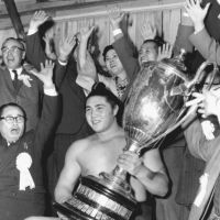 Just getting started: Surrounded by supporters, Taiho, a sekiwake at the time, celebrates after winning his first championship at the Kyushu Grand Sumo Tournament in November 1960. Taiho went on to become one of the sport's greatest yokozuna, winning a record 32 tournaments through 1971. He died Saturday at age 72 in a Tokyo hospital. | KYODO