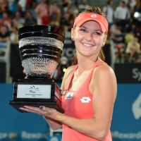 Overpowering performance: Poland's Agnieszka Radwanska holds her trophy after beating Slovakia's Dominika Cibulkova 6-0, 6-0 in the final of the Sydney International on Friday. | AFP-JIJI