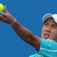 Fun down under: Kei Nishikori prepares to serve during his 6-7 (5-7), 6-3, 6-1, 6-3 first-round win over Romania's Victor Hanescu at the Australian Open on Monday. | AP