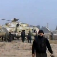 Flights suspended: In this image taken from a video obtained by Ugarit News, rebel troops capture a helicopter base near Damascus on Sunday.   AP