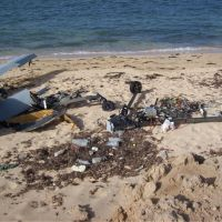 Armed and out of control: An MQ-1 Predator armed with a Hellfire missile flies a training mission in Nevada. Right: Divers recovered the wreckage of an armed MQ-1B drone that crashed off Djibouti City on May 7, 2011.   BLOOMBERG, THE WASHINGTON POST