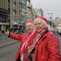Double trouble: Twin prostitutes Martine (left) and Louise Fokkens, 70, walk around Amsterdam on Nov. 15. | AFP-JIJI