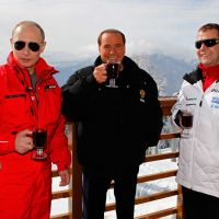Back in from the cold: Former Italian Prime Minister Silvio Berlusconi (center), then-Russian Prime Minister Vladimir Putin (left) and then-Russian President Dmitry Medvedev pose for a photo during a meeting in Krasnaya Polyana, Russia, in March. | AP