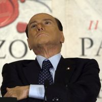 Will he or won't he?: People of Freedom party leader Silvio Berlusconi attends a book presentation of journalist Bruno Vespa's 'The Palace and the Square' in Rome on Wednesday. | AP