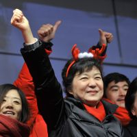 Poised to win: Presidential candidate Park Geun Hye (with antlers) of the ruling Saenuri Party campaigns  Tuesday in Seoul. | AFP-JIJI