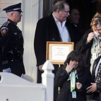 Teacher mourned: Family and friends leave the wake of Victoria Soto, a teacher at Sandy Hook Elementary School, in Stratford, Connecticut, on Tuesday.   AP
