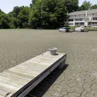 Stay inside, stay alive: A dock extends into a dry cove at Morse Reservoir in Noblesville, Indiana, as oppressive heat and drought conditions stifled parts of the United States last summer. | AP