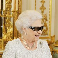 Modern monarch: Queen Elizabeth II wears 3-D glasses to watch the recording of her Christmas message from Buckingham Palace on Sunday. | AFP-JIJI