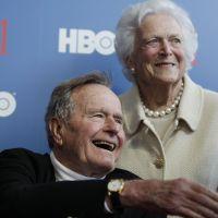 Full circle: Former President George Bush and his wife, Barbara, arrive for the premiere of an HBO documentary about his life in Kennebunkport, Maine, in June. | AP