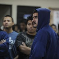 In limbo: A group of 375 Guatemalan would-be migrants who were deported from different parts of the U.S. wait to be registered by migration authorities upon their arrival at the U.S. Air Force base in Guatemala City on Dec. 28. | AFP-JIJI