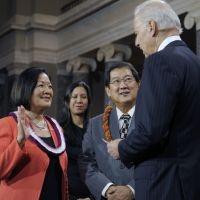 Capitol gain:  Vice President Joe Biden administers the Senate oath to Sen. Mazie Hirono, a Hawaii Democrat, accompanied by her husband, Leighton Kim Oshima, during a mock swearing-in ceremony on Capitol Hill on  Thursday. | AP