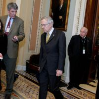 Questionable influence: Senate Majority Leader Harry Reid walks from the Senate chamber to a caucus in the Capitol on Dec. 30. Reid is just one of many lawmakers whose family members are also lobbyists. | AFP-JIJI